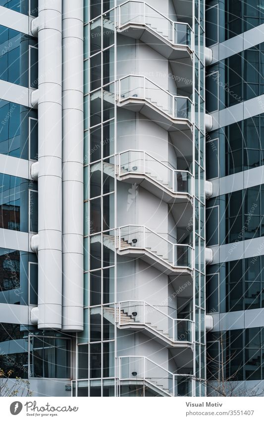 Outdoor stairs and glass facade of an office building windows architecture architectural architectonic urban metropolitan constructed edifice structure