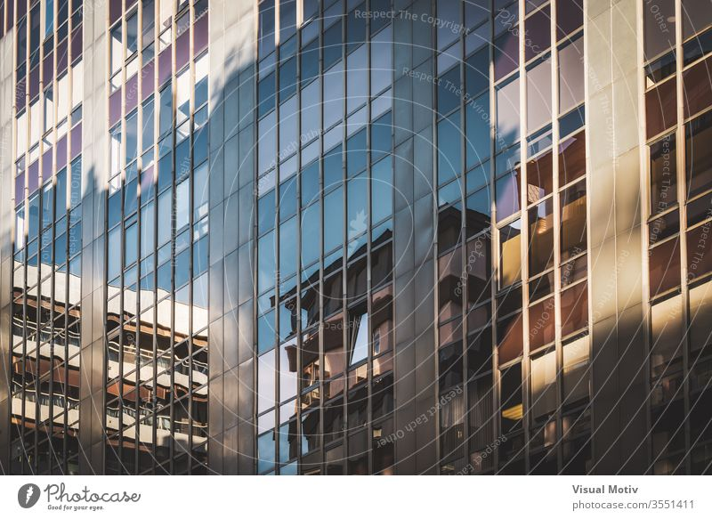 Glass windows of an office building contemporary finance business commercial abstract organized city modern architecture business building angle light