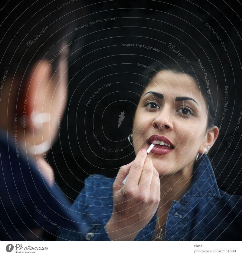 Estila Woman Lipstick Apply make-up Jacket Mirror Mirror image Jewellery Earring Feminine feminine Dark-haired Looking Face