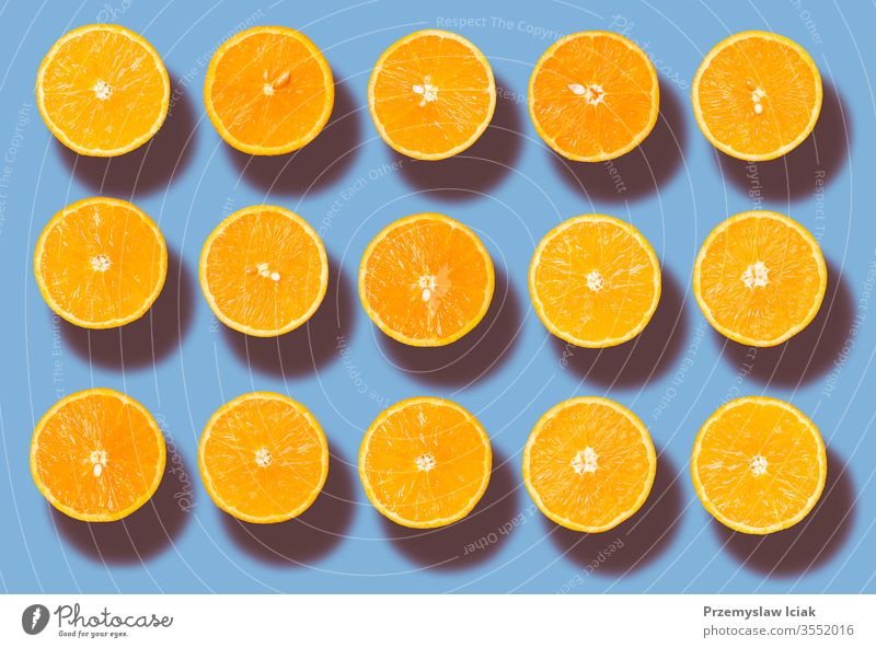 Background of half cut organic oranges in row Freshness background bio blue citrus closeup color colour food fresh fruit health healthy juicy natural nature