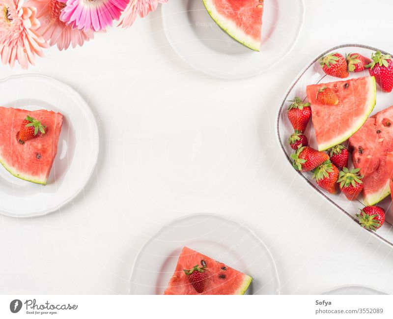 Watermelon slices on tray on white wooden table watermelon summer strawberries ceramic pink fresh snack flowers delicious beautiful bright eat food sweet party