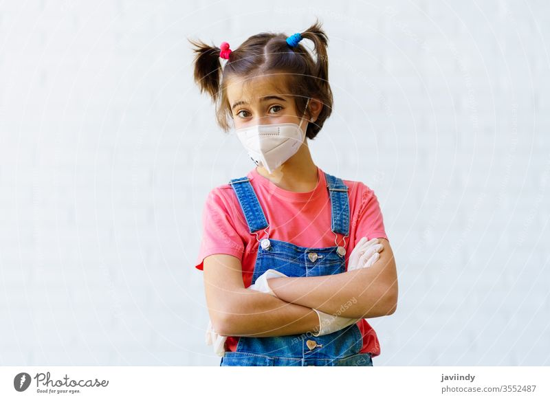 Child girl wearing a protection mask against coronavirus during Covid-19 pandemic kn95 covid-19 caucasian children safety sick female ill illness outdoors young