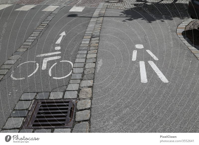 A bicycle path with pedestrian walkway Cycle path, traffic, road, environment, city, urban Transport Street Traffic infrastructure Signs and labeling