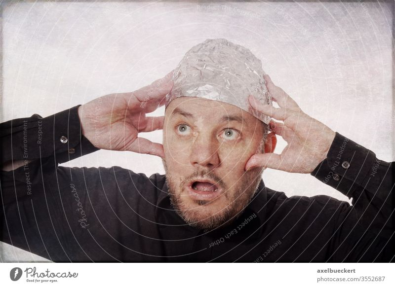 Conspiracy theorists and aluminium hat carriers Aluminium hat carrier Conspiracy theory Fear Funny Panic Whimsical Man 5g electromagnetic radiation mind control