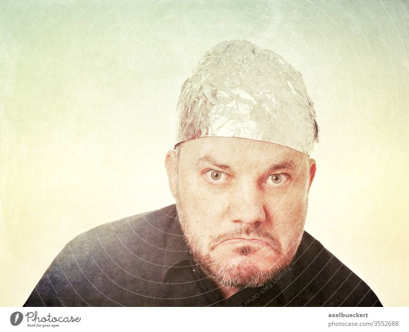 Angry citizen with aluminium hat Aluminium hat carrier angry bourgeois Conspiracy theory rabid Skeptical Bad mood aluminium foil Hat Protection mind control