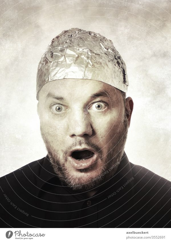 shocked man with aluminum hat - conspiracy theories aluminium hat Aluminium hat carrier Conspiracy theory Shock aluminium foil Hat Protection mind control