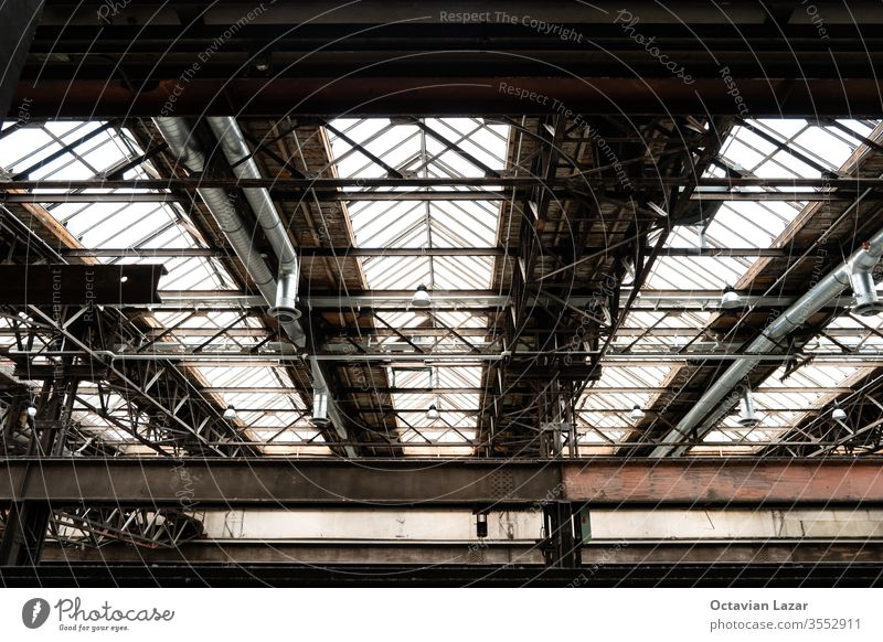 Old disabled heavy industry factory machinery inside low angle shot moving rig rail motorized electric abandoned industrial technology power steel energy