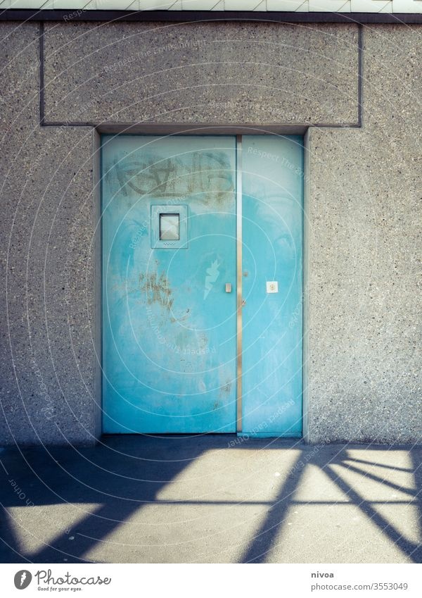 Door Shadow Turquoise Blue Metal Wall (building) Window Closed White Entrance House (Residential Structure) Deserted Colour photo Exterior shot Wall (barrier)