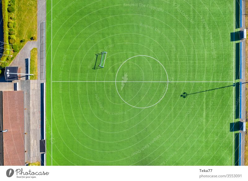 On the football field #1 soccer Sports from on high drone Sporting grounds green Empty Ball sports