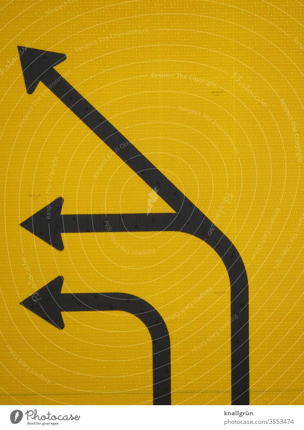 Partial view of a traffic route, three black directional arrows, pointing to the left, on yellow background Signs and labeling Road sign Arrow direction arrow