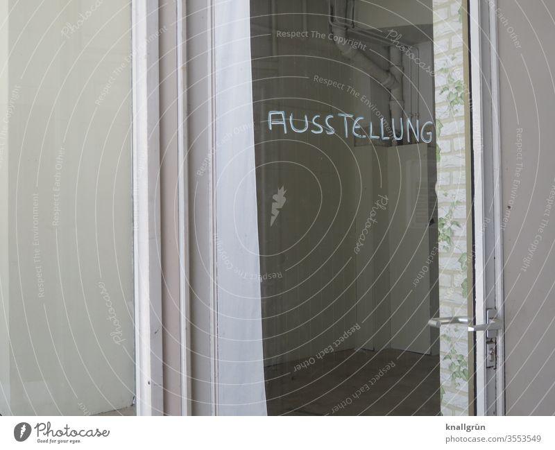 Triste Galerie, on whose glazed entrance door the handwritten word EXHIBITION is written gallery Exhibition Art Deserted Exterior shot Glass door Gloomy White