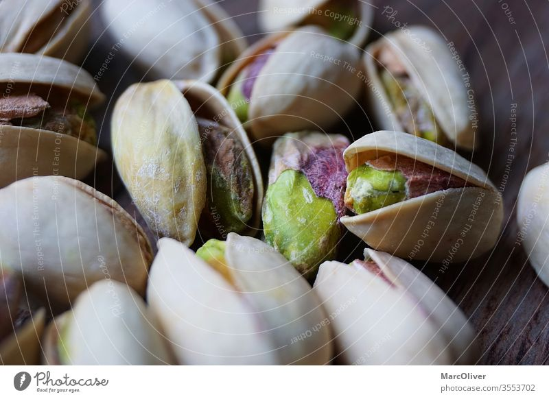 Pistachios with shell Pistachios with mussels Pistachio shells Pistachio with shell Nut Food Snack nuts Healthy Sámen salted Shell Heap fruit natural Group