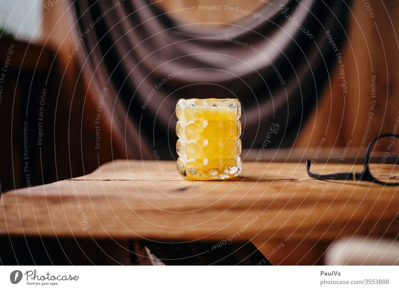 Glass with orange juice on wooden table Orange juice Breakfast Juice glass vitamins Vitamin C Nutrition salubriously vacation fruit Food smoothie Table Beverage
