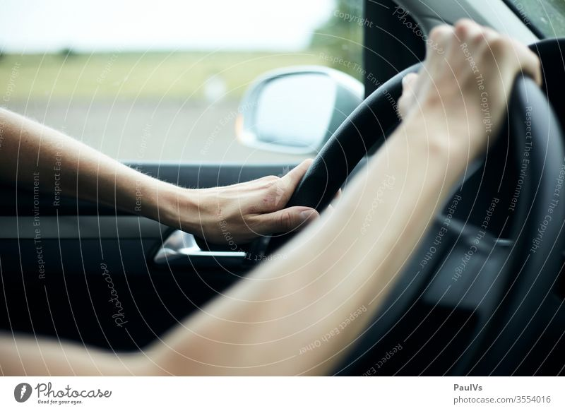 motorist with both hands on the steering wheel Steering wheel Motoring Hands on the steering wheel Handlebars Driver Car journey Highway jam Transport