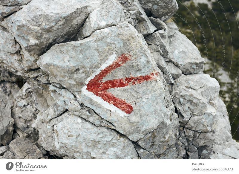 Directions red arrow on rock stone hiking trail Arrow off route Alpine Austria red white mountain Mountain Mountaineering Alps Hiking Peak Nature Climbing Stone