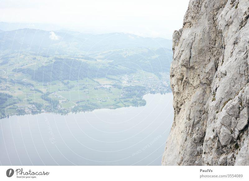 Rock face next to lake in Salzkammergut Austria Traunstein Wall of rock Lake Salzkammergut Lake Traunsee Gmünden Upper Austria Pre-alpes ostalpen Climbing
