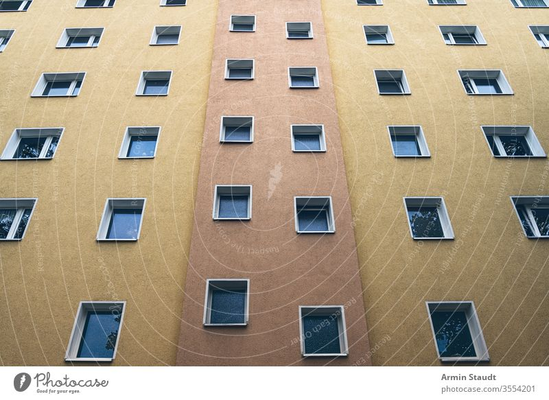 simple orange and yellow facade of a house Facade social housing projects kreuzberg apartment seamless architecture background backlight backlit beautiful