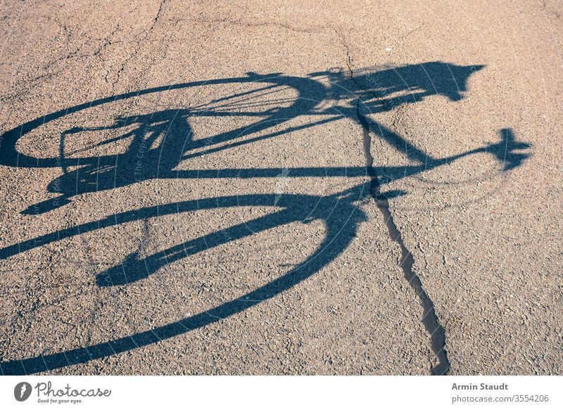 shadow of a bicycle on the street cycling outdoor biking activity lifestyle asphalt bike city leisure nature old outdoors outside pedal road silhouette sport