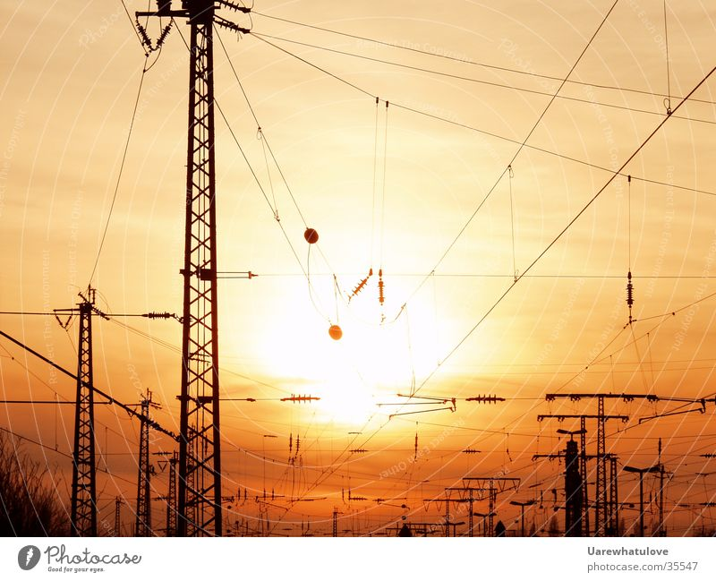 energy age Electricity Sunset Electricity pylon Red Yellow Environmental pollution Transport Energy industry Train station Cable Net smock