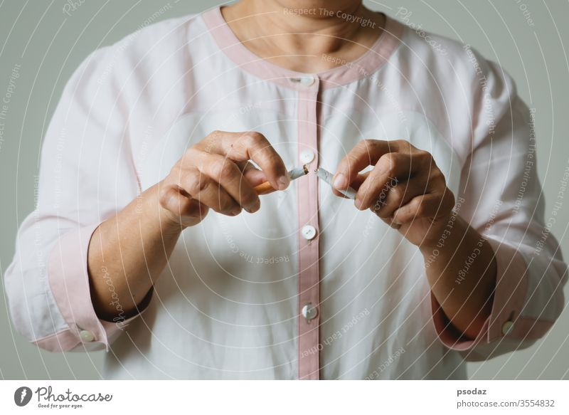 Quit smoking, no tobacco day, mother hands breaking the cigarette addict adult aged anti background bad beautiful broken care caucasian close up concept danger