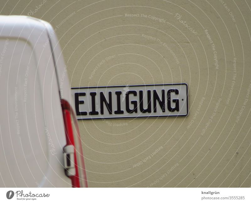Sign with the word CLEANING, where the R is hidden by the rear of a van cleaning Signs and labeling Signage Characters Exterior shot Colour photo Subdued colour