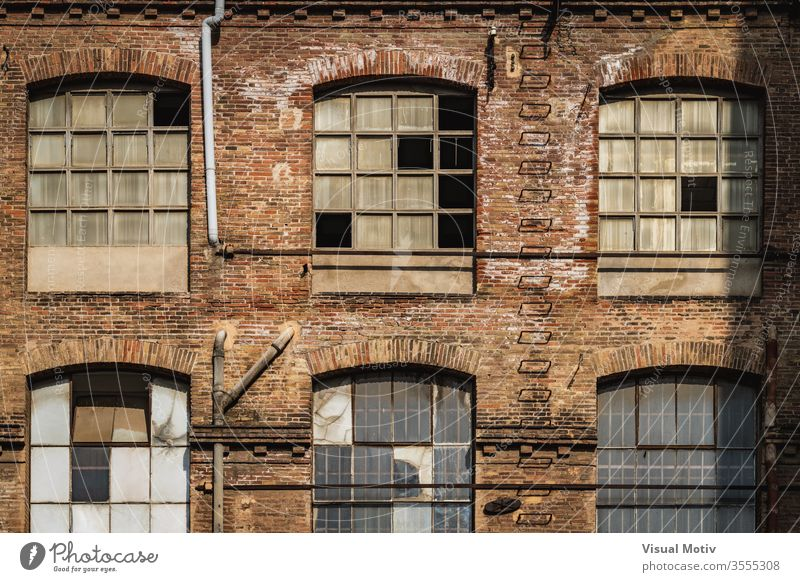 Windows of an old textile factory at the afternoon light building facade industry windows architecture architectural architectonic urban metropolitan