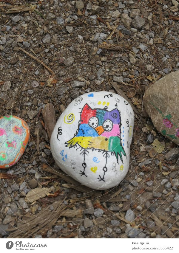 Lucky stone painted with a colourful owl on a white background Lucky Stones Leisure and hobbies Creativity Painting (action, artwork) Draw Art Multicoloured