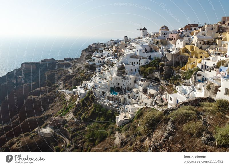View on Greek village with wind mill, Oia, Santorini, Greece greece travel sunset oia ocean santorini europe blue architecture tourism sky color caldera