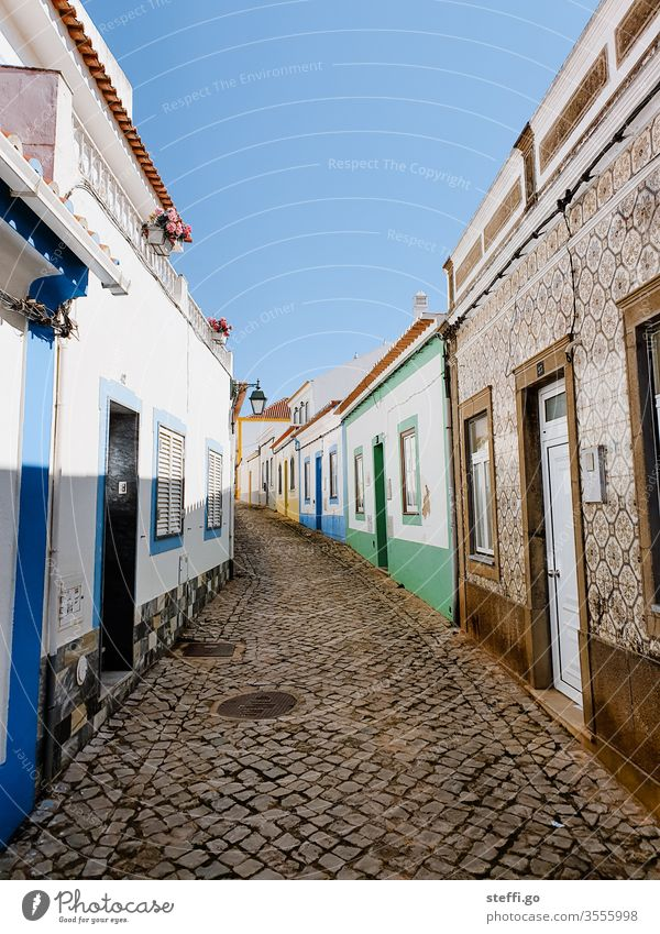 small alley with colourful houses without people in Ferragudo, Portugal Europe Alley Old town Vacation & Travel House (Residential Structure) Architecture