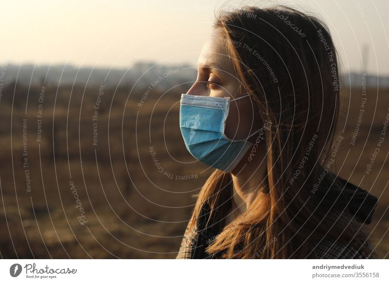 close up of Photo of a woman wearing protective mask against infectious diseases, coronavirus, covid-19 and flu outdoors. copy space. Coronavirus outbreak in Europe. Flu epidemic spread prevention