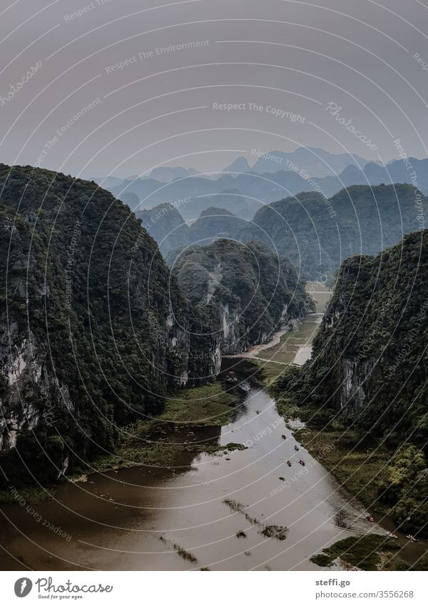 View of the rock and karst landscape of Ninh Binh in Vietnam; dry Halong Bay karst mountains dry halon bay Dry Halong Bay Rock Mountain Halong bay Ocean Asia