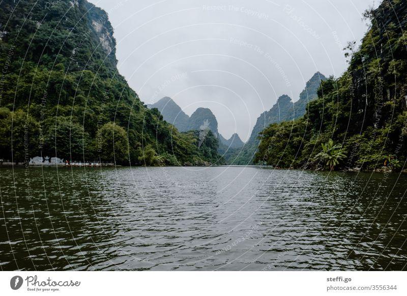 Water landscape between mountains and rocks in Ninh Binh, Vietnam karst karst landscape karst mountains dry halon bay Dry Halong Bay Rock Mountain Halong bay