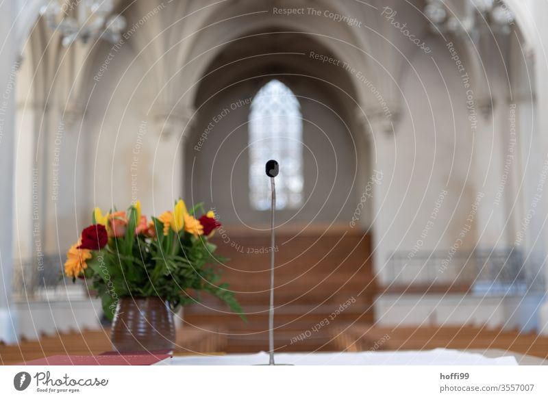 Altar with flowers and microphone in front of empty church Church Microphone Bouquet Sanctuary Deserted Blank space lockdown Corona virus Protection