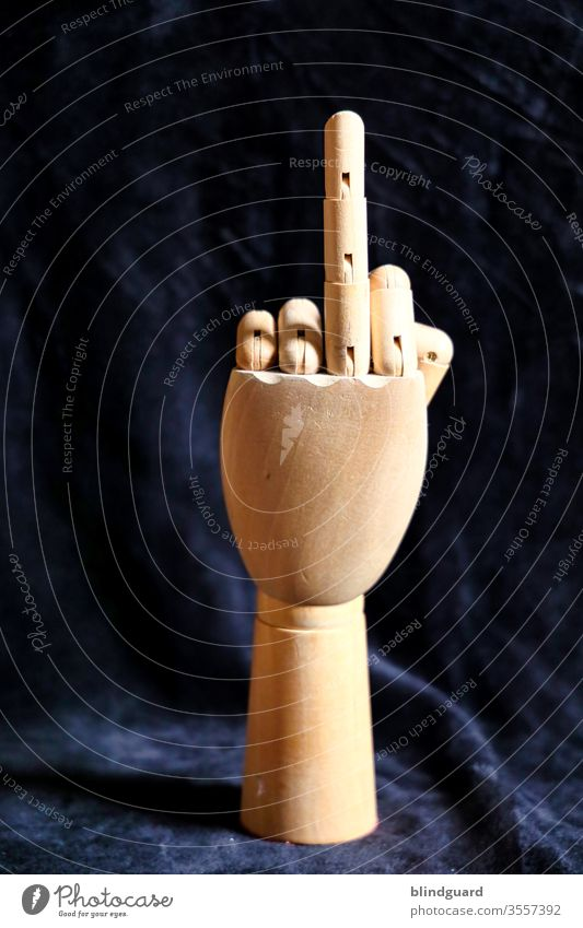Symbol of provocation. Wooden hand for anatomical, artistic drawing, which raises a finger to demonstrate to those responsible the criticism of the handling of art and culture in the Corona crisis.