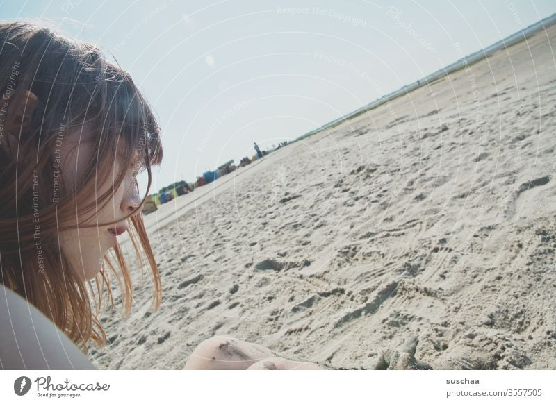 teenager sitting on a beach at low tide with a sloping horizon Youth (Young adults) Profile Face hair Sit Summer Sun Beach Sand Ocean North Sea Low tide Tide