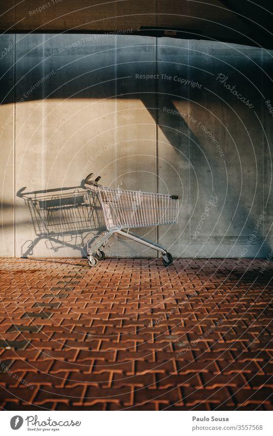 Empty shopping cart Shopping Shopping basket consumerism Economy Shopping Trolley Supermarket Consumption Metal Colour photo Deserted Basket Trade Exterior shot