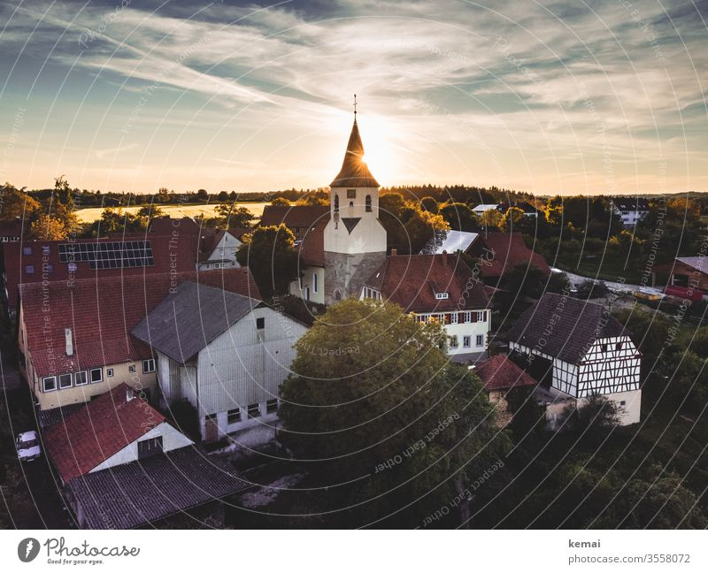 Village with village church in the evening light UAV view droning Light Back-light Sun Sunlight Evening sun warm country rural Idyll Country life Church