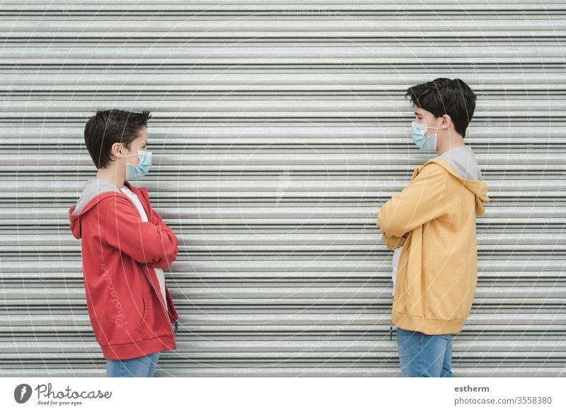 two kids with medical mask maintain social distancing coronavirus children epidemic pandemic quarantine prevention friendship brothers symptom medicine health