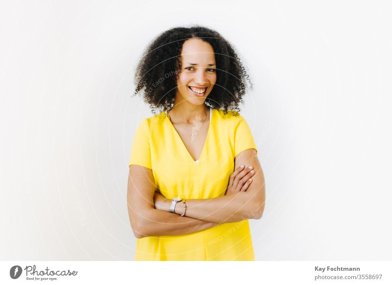 Portrait of smiling woman with crossed arms 25-30 more adult African-American Attractive already Beauty & Beauty Black Self-confidence Curly Day emotion Ethnic