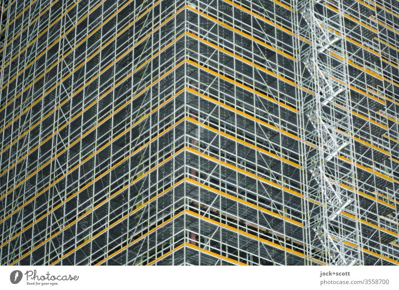 High-rise building completely scaffolded Authentic Advancement Modernization Many Symmetry staircases conversion Worm's-eye view