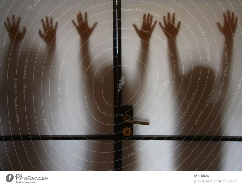 hands up Shadow Silhouette by hand Fingers Body door Glass door Frosted glass Window pane Creepy Transparent Shadow play Mysterious Hide Phantom Anonymous