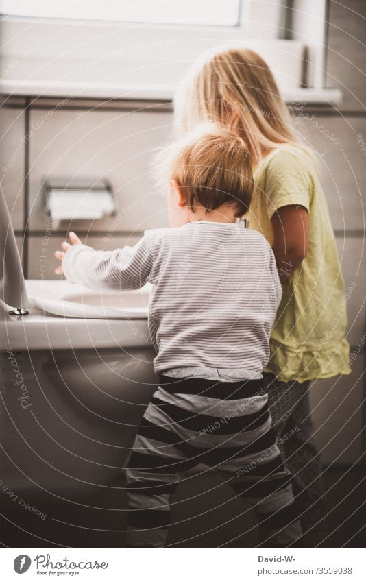 Big sister and little brother are fooling around Sister Brother Brothers and sisters Infancy Boy (child) girl Toilet bunkum Incite Study Brash wittily