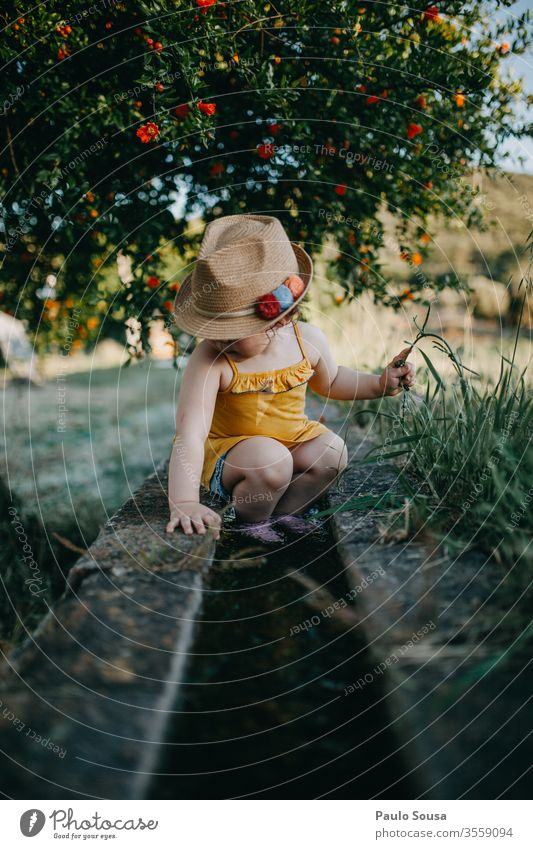 Child with hat Pomegranate Nature Hat Summer Summer vacation Spring Vacation & Travel Exterior shot Infancy Colour photo Lifestyle Day Happiness Toddler