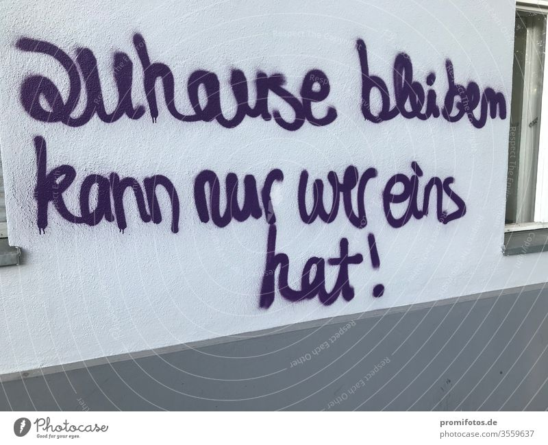 "Graffiti: ""only those who have one can stay home!"" Seen on a house wall. Photographer: Alexander Hauk Homelessness Art Wall (building) purple protest"