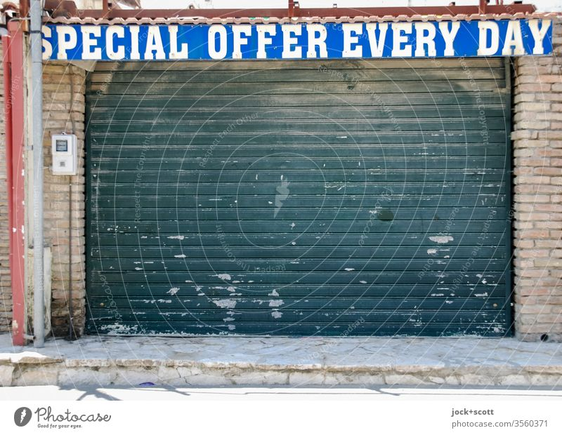 taken literally | Aha! special offer every day Souvenir shop Roller shutter English Typography upper-case letters Word Ravages of time Trade Change