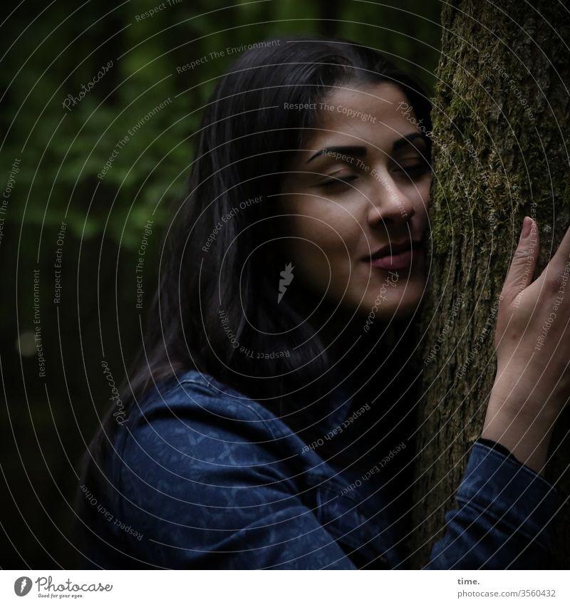 power source Woman Jacket Feminine feminine Dark-haired Face Closed eyes Long-haired Protection Inspiration Dream Lean Force tree Tree bark Tree trunk Trust