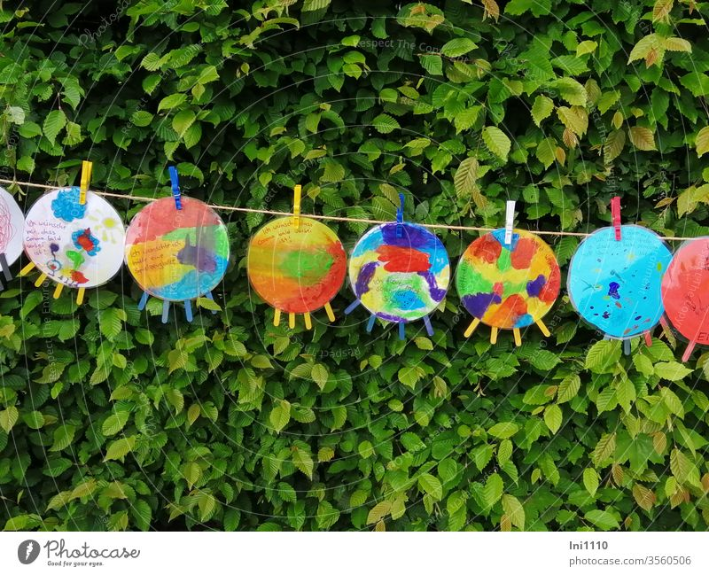 Corona viruses made by children from paper and painted, hung up on string with clothes pegs corona virus Solidarity Compassion Loneliness Attachment