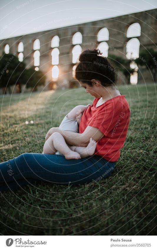 Mother nursing outdoor motherhood Nursing breastfeed Family & Relations Love Woman Baby Child Caucasian femininity Feminine Parents Infancy Beautiful Happy Home