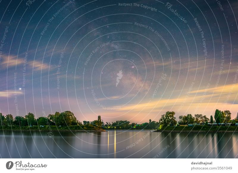 The galactic center photographed from the shore of the river Rhine at Mannheim. rhine mannheim water lido camping blue landmark stone universe space beach night