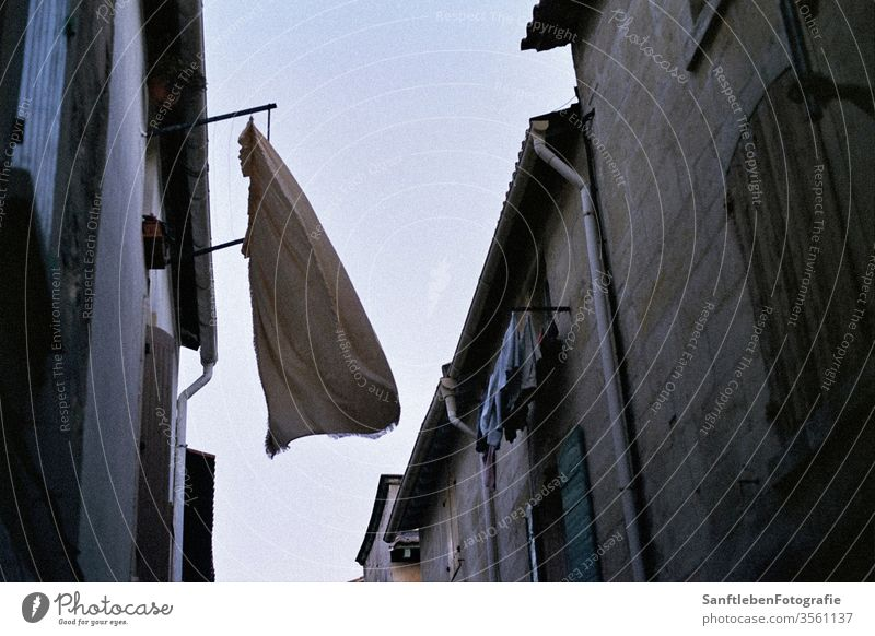 Washing in the wind Wind Summer Twilight Southern France Laundry Deserted Exterior shot Washing day Dry hang Street Colour photo Backyard freshness